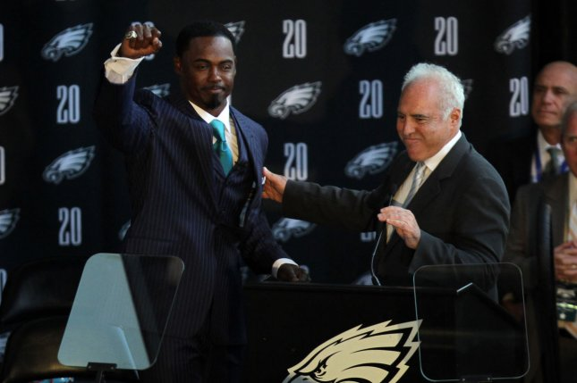 Former Philadelphia Eagles player Brian Dawkins (L) cheers with the crowd, with Eagles' owner Jeffrey Lurie, after retiring his number to the Eagles Hall of Fame on September 30, 2012 at Lincoln Financial Field in Philadelphia. File photo by Laurence Kesterson/UPI