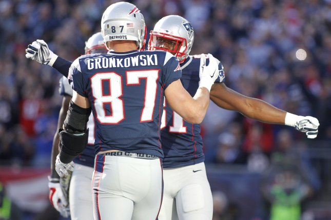 New England Patriots tight end Rob Gronkwski (87) gives a hug to fellow tight end Tim Wright after Wright scored on a four-yard touchdown reception during a game in 2014. File photo by Matthew Healey/UPI