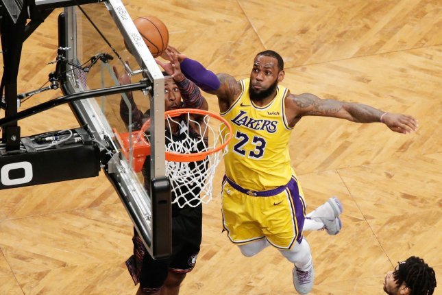 a7356d3643d2f Los Angeles Lakers forward LeBron James and Brooklyn Nets forward Rondae  Hollis-Jefferson reach for a rebound in the first half on December 18 at  Barclays ...