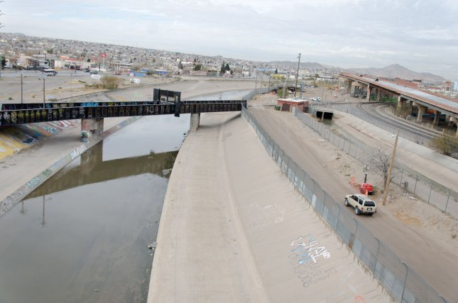 The border between El Paso, Texas, and Juarez, Mexico, is separated by the Rio Grande river and a chain link fence on the U.S. side as seen from the Paso Del Norte bridge. Photo by Natalie Krebs/UPI