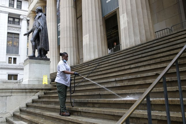 A worker is seen near a statue of former President George Washington outside the New York Stock Exchange on Wall Street in New York City on Tuesday. Photo by John Angelillo/UPI