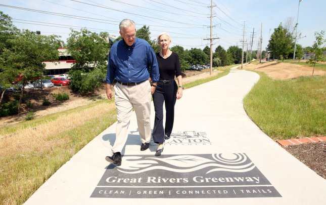 Right clothes for exercising increase odds of staying active.Missouri Governor Jay Nixon and First Lady Georganne Nixon walk on the Great Rivers Greenway walking path in Clayton, Missouri during Nixon's 100 Missouri Miles Challenge on June 14, 2103. The program challenges Missourians to join the Governor and First Lady to complete 100 miles of outdoor activity in 2013 and track their progress at 100MissouriMiles.com. UPI/Bill Greenblatt