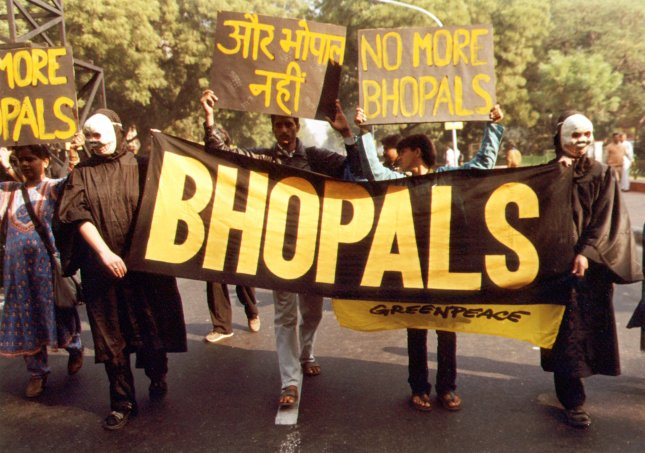 Greenpeace activists demonstrate in the Indian capital of New Delhi, on December 3, 1999, to mark the 15th anniversary of the poisonous gas leak from the Union Carbide pesticide plant in Bhopal, which left nearly 3,000 people dead. UPI File Photo