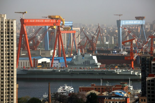"""A new """"block"""" has emerged at the Dalian Shipyard in northeast China, where China's first self-built aircraft carrier was assembled and deployed. Photo by Stephen Shaver/UPI"""