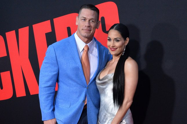 John Cena (L) with Nikki Bella. A representative for Bella has said that the pair are working on their relationship. File Photo by Jim Ruymen/UPI