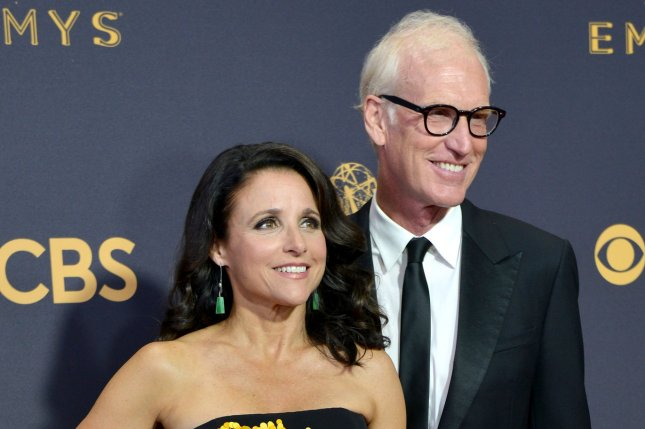 Julia Louis-Dreyfus (L), pictured with Brad Hall, looked happy and healthy during a trip to Lanai with the actor. File Photo by Christine Chew/UPI