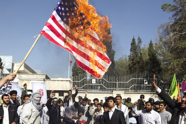 Iranian demonstrators burn an American flag in Tehran, Iran. The nation's top court ruled Tuesday an accused spy linked to the CIA will be executed. File Photo by Maryam Rahmanian/UPI