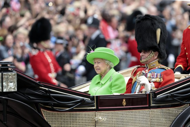Queen Elizabeth II and the Duke of Edinburgh travel in an open state carriage during a celebration of the Queen's 90th birthday in London, Britain, on June 11, 2016. File Photo by Hugo Philpott/UPI