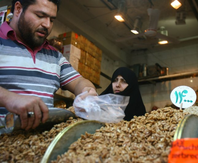 An Iranian woman buys walnuts on the first day of the Muslim fasting of Ramadan on August 22, 2009. Muslims around the world give up from eating, and drinking from sunrise to sunset during Ramadan, the holiest month in the Islamic calendar. UPI/Maryam Rahmanian