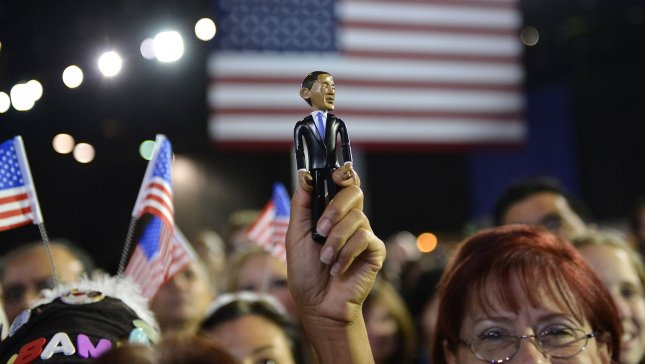A President Barack Obama supporter raises an Obama statue during his election night event in Chicago on November 6, 2012. UPI/Brian Kersey