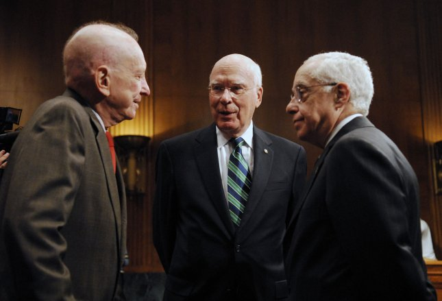 U.S. Attorney General Michael Mukasey (R) speaks with Sen. Arlen Specter (R-PA) (L) and Senate Judiciary Committee chairman Sen. Patrick Leahy (D-VT) before a hearing on oversight of the U.S. Department of Justice on Capitol Hill in Washington on July 9, 2008. (UPI Photo/Alexis C. Glenn/File)