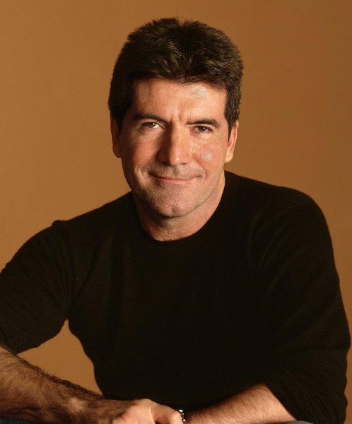 Simon Cowell, a judge on the American Idol television show is pictured in this publicity photo released by Fox television. EDITORIAL USE ONLY (UPI Photo/Fox/HO)