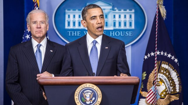 Vice President Joseph R. Biden (L) looks on as President Barack Obama makes a statement in the White House Briefing Room following passage by the House of tax legislation on January 1, 2013 in Washington, DC. The House and Senate have now both passed the legislation, averting the so-called fiscal cliff. UPI/Brendan Hoffman/Pool