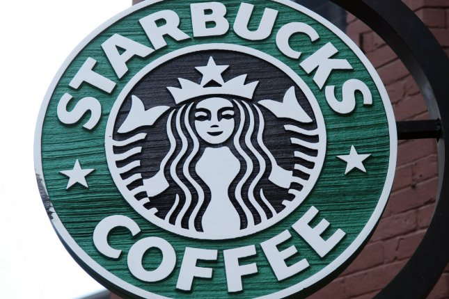 A Starbucks sign is pictured outside the coffee shop chain in Washington on July 2, 2008. On Monday, Starbucks responded to criticism over a sign barring women from entering a Starbucks in Riyadh, saying a gender wall has been re-built. File photo by Alexis C. Glenn/ UPI