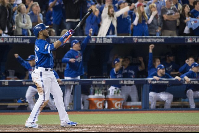 Toronto Blue Jays' Edwin Encarnacion celebrates his game-winning three-run home run in the eleventh inning of the AL wild card game against the Baltimore Orioles at the Rogers Centre in Toronto, Canada on Tuesday, October 4, 2016. Photo by Darren Calabrese/UPI