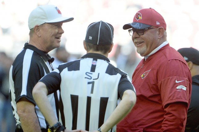 Arizona Cardinals head coach Bruce Arians (R) talks with Referee Carl Chaffers (L) and Side Judge Scott Novak (C) before the Cardinals-New Orleans Saints game at University of Phoenix Stadium in Glendale, Arizona, on December 18, 2016. File photo by Art Foxall/UPI