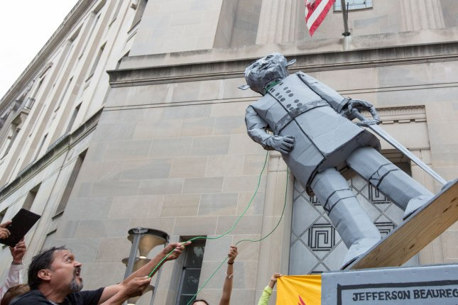 Demonstrators pull down an effigy of Attorney General Jeff Sessions at the U.S. Justice Department during a rally against the Trump administration's immigration policies on September 6. File Photo by Erin Schaff/UPI