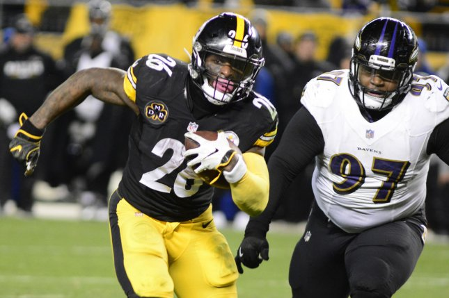 Pittsburgh Steelers running back Le'Veon Bell (26) runs pass Baltimore Ravens nose tackle Michael Pierce (97) and scores an 11-yard touchdown in the 39-38 win over the Baltimore Ravens on Decemer 10, 2017 at Heinz Field in Pittsburgh. Photo by Archie Carpenter/UPI