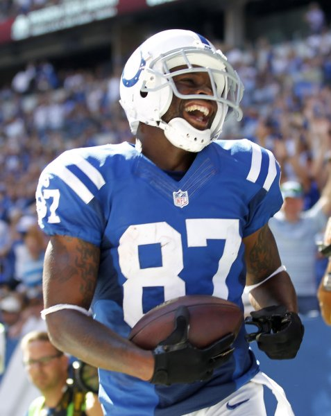 Former Indianapolis Colts receiver Reggie Wayne celebrates a touchdown against the Tennessee Titans during a game in 2014. Photo by John Sommers II/UPI