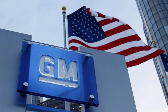 The GM logo is displayed near the General Motors global headquarters at the Renaissance Center in Detroit. File Photo by Brian Kersey/UPI