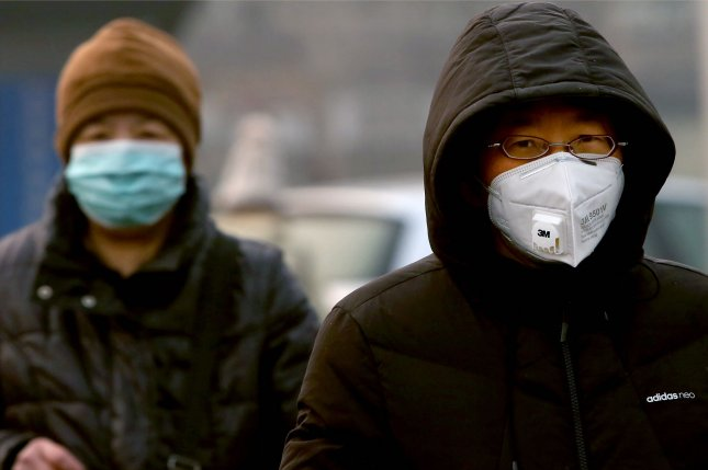 Chinese people wear protective face masks due to the threat of the deadly coronavirus, named Covid-19, in Beijing on Thursday, February 13, 2020. Photo by Stephen Shaver/UPI
