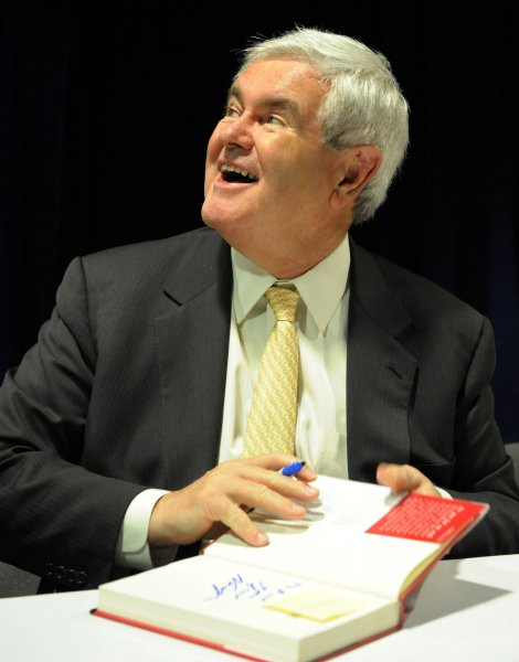 Former House Speaker Newt Gingrich, R-GA, signs copies of his new book Real Change: From the World that Fails to the World that Works at the American Conservative Union's annual Conservative Political Action Conference in Washington on February 27, 2009. (UPI Photo/Roger L. Wollenberg)