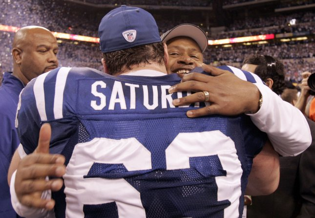 Indianapolis Colts Coach Jim Caldwell hugs center and Colts Players' Union representative Jeff Saturday (63) after their 30-17 win over the New York Jets in the AFC Championship game Jan. 24, 2010. (UPI Photo/Mark Cowan).