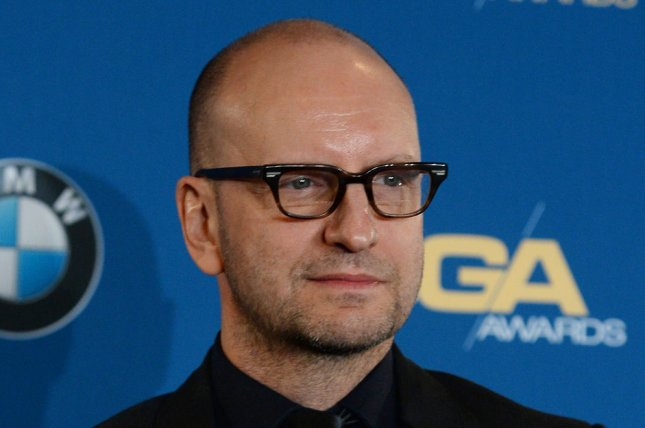 Director Steven Soderbergh appears backstage with the award he garnered for Outstanding Directorial Achievement in a TV Movie or Miniseries for his film Behind the Candelabra at the 66th annual DGA Awards in Los Angeles on January 25, 2014. UPI/Jim Ruymen