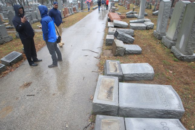 Visitors to the Chesed Shel Emeth Cemetery in University City, Mo., on Tuesday see headstones damaged after vandals toppled nearly 200 stones in the Jewish cemetery. The cemetery dates to the 1800s. Photo by Bill Greenblatt/UPI