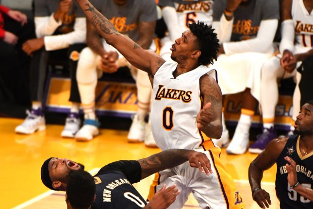 Los Angeles Lakers guard Nick Young (R) shoots over Pelicans center DeMarcus Cousins (L) at Staples Center in Los Angeles, March 5, 2017. Photo by Jon SooHoo/UPI