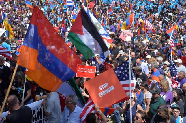 Thousands of people march from Pan Pacific Park in Los Angeles to mark the 102nd anniversary of the Armenian genocide in Los Angeles on Monday. Photo by Jim Ruymen/UPI