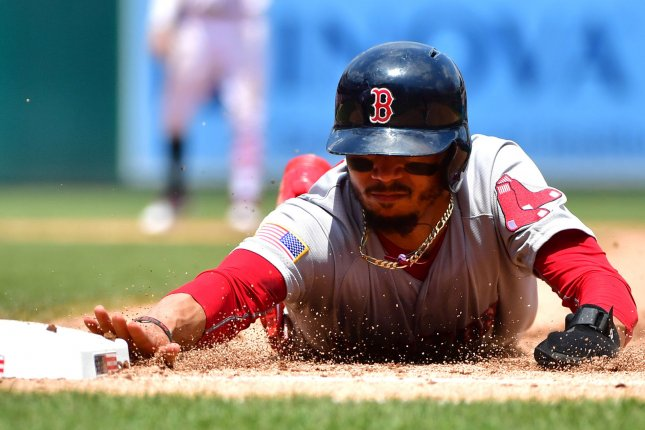 Boston Red Sox right fielder Mookie Betts (50) slides back into first in the sixth inning against the Washington Nationals on July 4 at Nationals Park in Washington, D.C. Photo by Kevin Dietsch/UPI