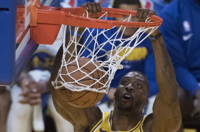 Los Angeles Lakers center Dwight Howard (39) scored his only two points on a second-quarter dunk during a win against the Atlanta Hawks Sunday in Atlanta. Photo by Terry Schmitt/UPI