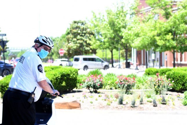 A security guard checks stores in Firewheel Town Center in Garland, Texas, on Friday. Photo by Ian Halperin/UPI