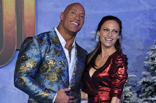 Dwayne Johnson said Wednesday that he, his wife, Lauren Hashian, and his two daughters are on the mend after testing positive for COVID-19 about three weeks ago. File Photo by Jim Ruymen/UPI