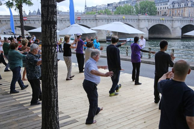 New research suggests that tai chi may be as effective as regular exercise at eliminating belly fat. File Photo by David Silpa/UPI