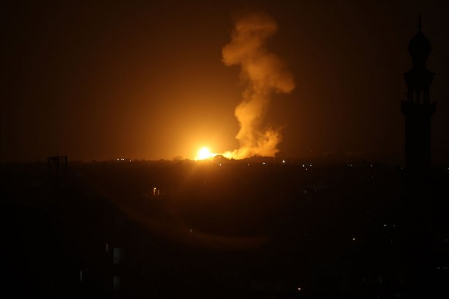 Smoke and flames rise after Israeli army war planes carried out airstrikes over Khan Younis, in the Gaza Strip, on Monday, where the Israeli military said it hit a Hama weapons manufacturing site. Photo by Ismael Mohamad/UPI