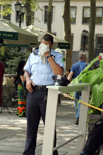 A security officer tries to cool off in the heat in Bryant Park in New York on July 21, 2011. UPI /Laura Cavanaugh