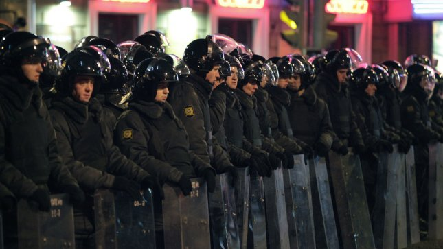 Russian riot police form a cordon during a massive rally Russia without Putin in Moscow to protest against Vladimir Putin's victory in a presidential election on March 5, 2012. UPI/Yuri Gripas