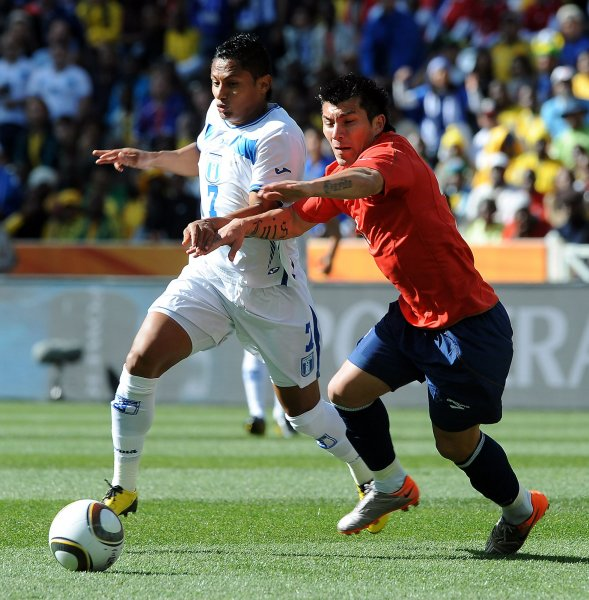 Ramon Nunez of Honduras and Gary Medel of Chile during the Group H match at the Mbombela Stadium in Nelspruit, South Africa on June 16, 2010. UPI/Chris Brunskill