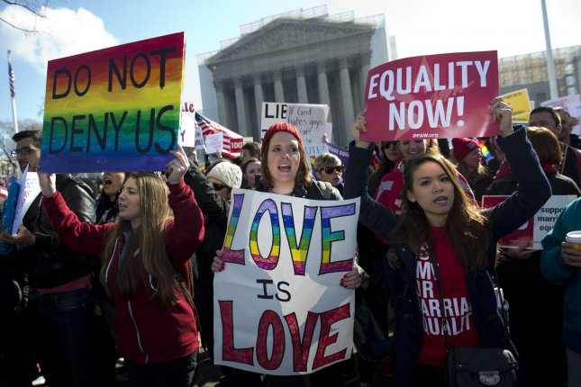 Same-sex marriage supporters rally in front of the U.S. Supreme Court as the Court hears arguments on same-sex marriage, in Washington, D.C. on March 26, 2013. UPI/Kevin Dietsch