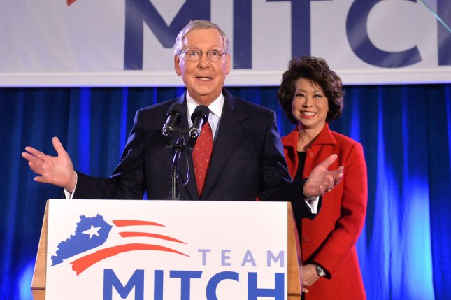 Senate Minority Leader Mitch McConnell, R-KY, joined by his wife Elaine Chao, speaks to supporters during his election night rally after retaining his Senate seat, in Louisville, Kentucky on November 4, 2014. McConnell defeated his Democratic challenger Alison Grimes. UPI/Kevin Dietsch