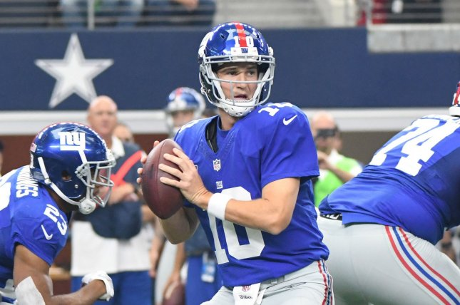 New York Giants' Eli Manning looks to throw against the Dallas Cowboys during the first half at AT&T Stadium in Arlington, Texas on September 11, 2016. Ian Halperin/UPI