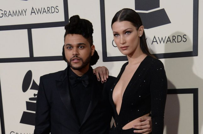 Bella Hadid (R) and The Weeknd at the Grammy Awards on February 15, 2016. File Photo by Jim Ruymen/UPI