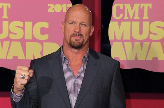 Stone Cold Steve Austin is returning to WWE to help celebrate the 25th anniversary of Raw with other wrestling legends. File Photo by Terry Wyatt/UPI