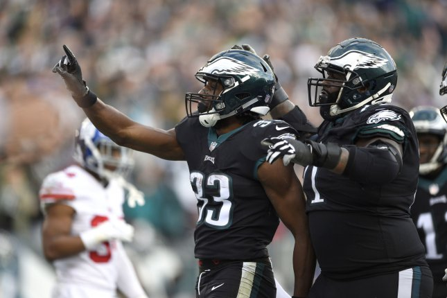 Philadelphia Eagles running back Josh Adams (33) celebrates with offensive tackle Jason Peters (71) after scoring a touchdown during the second half of an NFL football game against the New York Giants on Sunday at Lincoln Financial Field in Philadelphia. Photo by Derik Hamilton/UPI