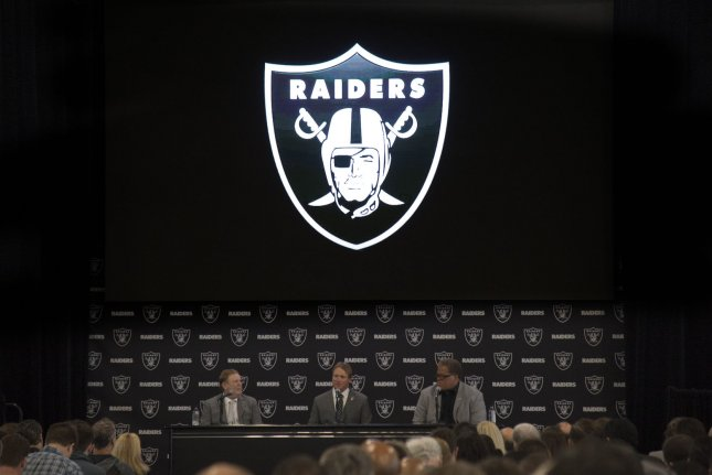 Oakland Raiders new head coach John Gruden (C) answers questions with owner Mark Davis (L) and Reggie McKenzie on January 9 at the Raiders Headquarters in Alameda, Calif. Photo by Terry Schmitt/UPI