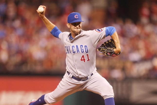 Cubs pitcher Steve Cishek was limping badly when he got into a cart to be taken for treatment. File Photo by Bill Greenblatt/UPI