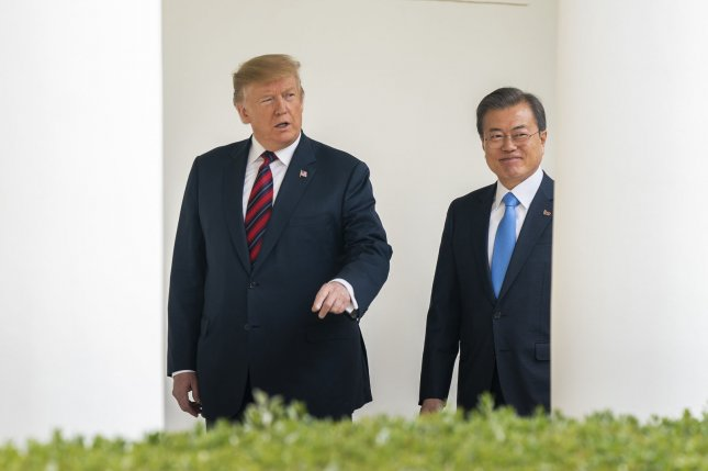 U.S. President Donald Trump (L) and South Korean President Moon Jae-in (R) have favored engagement with North Korea, but their administrations are less in agreement over U.S. military costs and transition of wartime operational control. File Photo by Jim Lo Scalzo/UPI