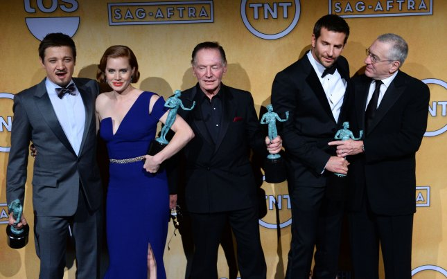 American Hustle cast members Jeremy Renner, Amy Adams, Paul Herman, Bradley Cooper and Robert De Niro (L-R) appear backstage after the movie was named Best Film during the 20th annual SAG Awards held at the Shrine Auditorium in Los Angeles on January 18, 2014. UPI/Jim Ruymen
